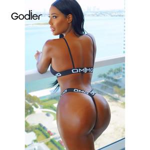 Venta al por mayor mujeres tentación vendaje cinturón cruzado sujetador 2018 lencería sexy letras empuja hacia arriba sin costuras íntimas negro conjunto de ropa interior panty