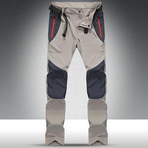Pantalones impermeables tácticos deportes al aire libre pesca que acampa Pantalones cargo de los hombres de primavera y verano de secado rápido de los pantalones de los hombres de 4XL