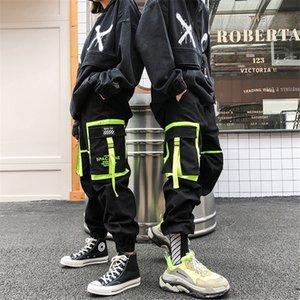 Hip Hip Preto Big bolso dos retalhos Harem Pants Men Joggers Calças dança Pant Ribbon Moda Outono Streetwear