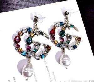 Alta qualità famosi gioielli di design in acciaio inossidabile di lusso placcati in oro colori orecchini per uomo donna prezzo all'ingrosso 6099
