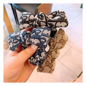 Filles Bandeaux Mode Bow Enfants Ruban élastique Bandeaux pour les femmes Accessoires cheveux Adolescent Filles Classique Cordes cheveux 4 Designs