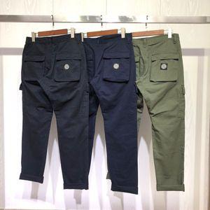 Uomini pantaloni denim moda sport casuali Sweatpant cotone allentato tessuto di qualità confortevole lettere pantaloni del piede OEM pulsante di carico del fascio