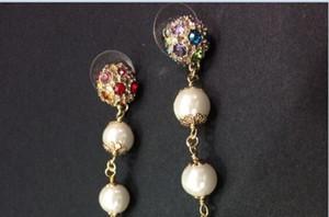 Flor clásica pendientes largos Pendientes de gota de cristal de color de lujo para la joyería de las mujeres Pendientes de moda con bolsas de franela para regalo de la joyería