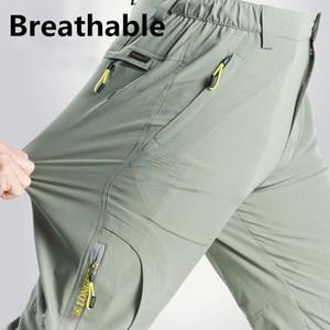 Senderismo al aire libre de los hombres jadea estiramiento de secado rápido transpirable impermeable de la pesca Softshell Pantalones hombre Pantalones de trekking camping Deportes