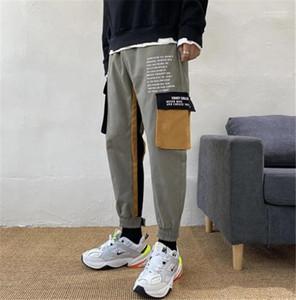 바지 슬림 맞춤 2020ss 남성 바지 패션 스플 라이스 색상 느슨한 바지 스포츠 연필 Pantalones 남성 하렘