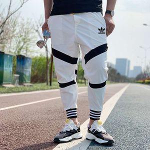 20030901 pantaloni da uomo di moda pantaloni da jogging donne Zipper Tute fascio Piedi Pantaloni irregolare Pantaloni Pantaloni Uomo Pantaloni
