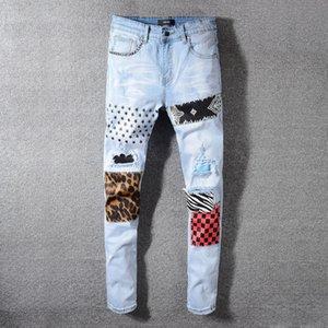 Gaojie marchio di moda in tessuto jeans del foro di patch degli uomini pantaloni stretti jeans sottili pantaloni stretti gambali 594