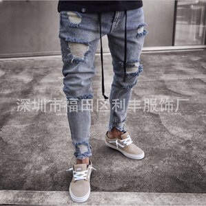 Designed for cross-border European and American fashion jeans for men the new men's zipper gray hole stretch pants feet