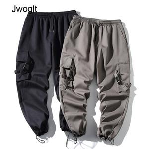 Pants bolso fita Hipster Homens Moda Sólidos Algodão Macacões japonês Streetwear Joggers Pants Men Designer Harem 4XL 5XL