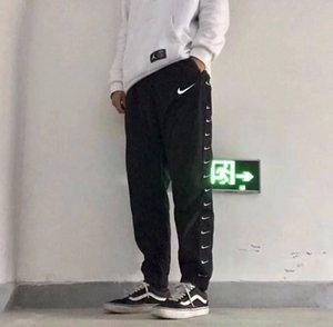 2020 pantalones de las mujeres casual impermeable etiqueta tejida tela suelta Cadena Tejido Negro clásico de cuatro estaciones usable Pareja Pantss M-XL
