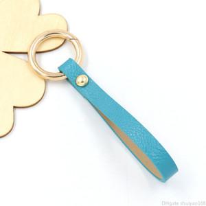 Pu cuir Keychain Wristband Boucle clé Styliste main voiture Porte-clé hommes Femme Sac Charm Pendentif Accessoires