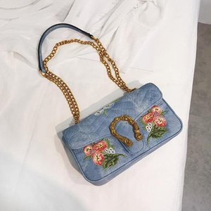 Factory wholesale selling brand ladies bag fashionable flowers embroidery chain bag overturned corrugated canvas oblique shoulder bag