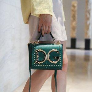 Luxus Designer Damen Handtaschen Metall-Nieten PU-kleine quadratische Taschen beiläufige Handygeldbeutel-Dame-Schulter-Umhängetaschen für Partei T200409