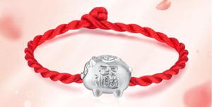 Altın domuz, gümüş domuz, Çince zodyak, kırmızı ip, altın zincir bilezik ve kırmızı ipi.