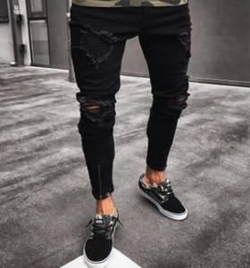 Progettista del Mens dei jeans dei pantaloni della matita primavera nera strappato Fori Solid Distressed design Jean tasche dei pantaloni Hommes Pantalones