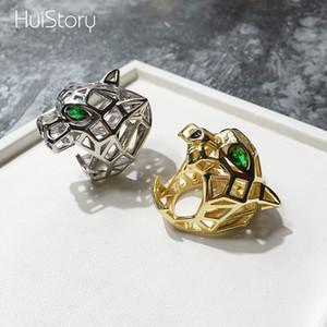 HUISTORY Couleur dorée évidée Green Eyed Léopard Tête Femmes Bague Avec Zircon Mode À La Mode Homme Bijoux Anneaux Pour La Fête