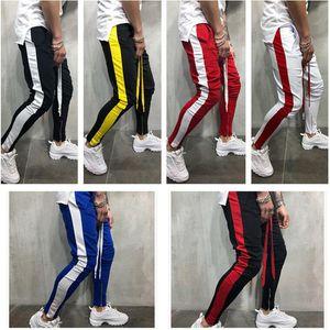 Nuevo Hip Hop Pantalones de contraste de color Pantalones de chándal para hombre Casual Rayas de rayas Color de remiendo Pantalones Jogger Ropa deportiva Pantalones de chándal Parte inferior