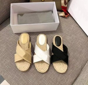 Early spring 2020 cross ribbon embroidered slippers women's fashion straw woven thick flat bottom beach shoes breathable cool 80335