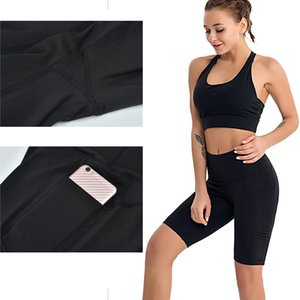 Ropa de la yoga de las señoras de la yoga de cinco puntos bolsillo para teléfono móvil lado de la aptitud de los pantalones de deportes de fitness pantalones cortos de baile