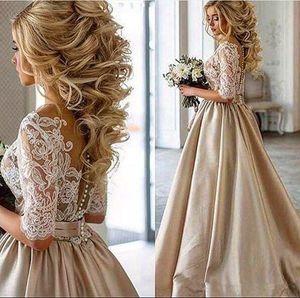 2020 New Vintage dentelle Stain champagne robes de mariée manches mi-longues Sheer cou couvert Botton pas cher Dubaï arabe Robe de mariée Real Photos 747