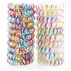 Gli anelli elastici dei capelli a forma di spirale di capelli della linea telefonica dell'anello dei capelli del cavo metallico unico di colore per uso delle ragazze freeshipping