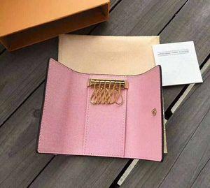 Original al por mayor multicolor caja de lujo carpeta corta seis mujeres clave titular de los hombres clásicos de bolsillo llavero de cuero real de la carpeta del clave 62630