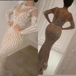 2021 Luxury Long Sleeve Sequins Silver Mermaid Prom Dresses Sexy Sheer Jewel Neck Evening Wear Beads Celebrity Prom Gowns