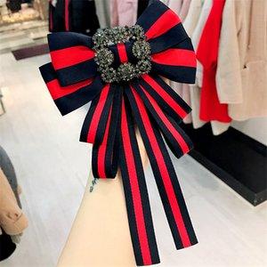 Donne eleganti' s Classic Spille Concise Style Stripe Red- nero Pins Delicato Wormanship Arco-nodo Brooches di modo per le donne