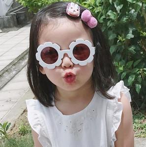 Novo bonito sol flor crianças óculos de sol homens e mulheres crianças selvagem côncava personalidade forma bebê anti-UV óculos de sol