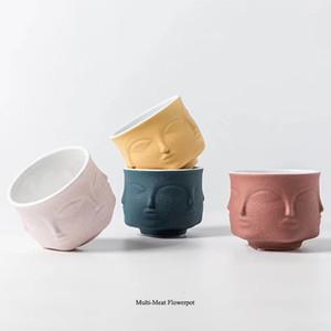 Fornasetti florero diseño creativo de la maceta nórdica estilo ornamentos de cerámica de la tabla cara de la flor taza de la vela de aromaterapia T191016