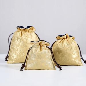 Il sacchetto di seta dei monili del broccato di seta di stile cinese ispessisce la borsa protettiva della collana del braccialetto del braccialetto delle perle di viaggio della tazza portatile 2pcs / lot