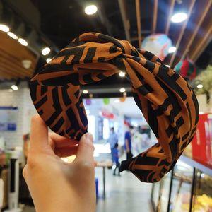Fashion and Simple design 2020 new style cross wide edge kink hair hoop simple high-grade letter head buckle face hair hoop headwear