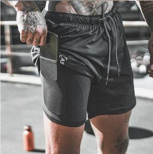 Nueva llegada del verano dos pisos de pantalones cortos para hombre de fitness culturismo transpirable de secado rápido de los hombres corto gimnasios Joggers casuales pantalones hasta la rodilla