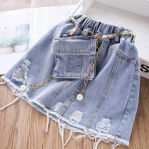 2020 nuove ragazze denim gonne + 2pcs tasca / set morbidi pantaloncini jeans delle ragazze fiancheggia i vestiti gonne a matita nappe bambini Kids Designer ragazze B702