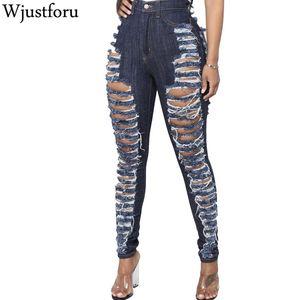 Wjustforu Sexy pantalones vaqueros del agujero de las mujeres de Bodycon del club lápiz de la manera del dril de algodón pantalones femeninos ahuecan hacia fuera los pantalones vaqueros azules Casual