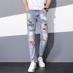 New season summer ripped jeans men's slim feet tide brand printing trend patch patch splash ink paint point fashion jeans