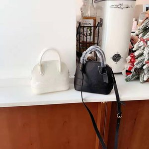The New 2020 Classic Cowhide Word Mother And Daughter Hand The Bill Of Lading Genuine Leather Handbag Shoulder Bags Shell Package