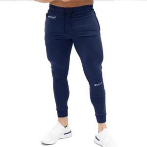 Pantalones de jogging para hombres Pantalones de entrenamiento de color sólido para gimnasia Ropa deportiva para jogging Mallas deportivas para hombres Correr con juramento Deportes