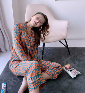 Traje de primavera de manga larga pijama de seda de las mujeres impresión de la manera floja fina nieve y el hielo de seda de la marca Home Use dos conjuntos