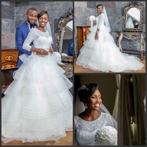 2020 Новый Нигерия Свадебные платья Jewel шеи с длинными рукавами Кружева Свадебные платья Многоуровневое юбки пляжа Boho свадебное платье плюс размер