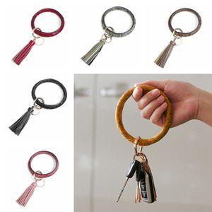 PU cuir ronde Bracelet porte-clés Mode femme Cercle Tassel Bracelet Porte-clés Creative Bangle Porte-clés Parti cadeau TTA1863-1