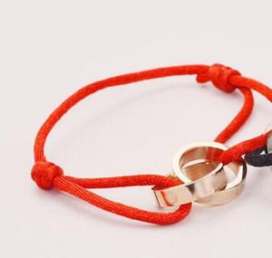 Любовь благотворительность красный веревка мужчина и женщина любовь браслет винт розового золота браслет титана стальной браслет