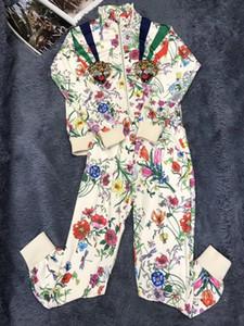 Kadın spor pantolon takım elbise moda standı yaka rahat kaplan nakış LOGO yaka rahat pantolon takım elbise durmak
