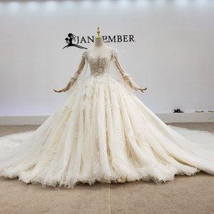 2020 Latest Modest Wedding Dresses Illusion O Neck Feather Long Sleeve Shining Badede Sequins Crystal Lace Up Back Sexy Boho Wedding Dresses
