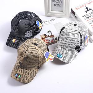 Оптовая взрослые шапки мужские и женские весенняя и летней газеты граффити моды бейсболка корейского Harajuku Cap редактор газеты козырек