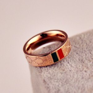 Retail and wholesale of 18K Rose Gold Plated classical red-green pattern letter Titanium steel ring couples in 2019