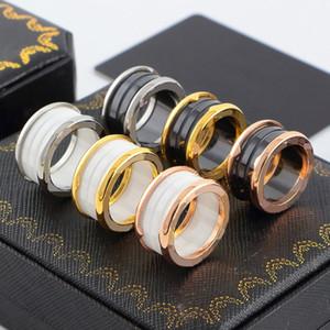 Novos anéis de primavera chegada 316L Titanium banda de aço com branco ou preto de cerâmica Tamanho 5-12 # Homens e Mulheres marca de jóias livre presente de casamento