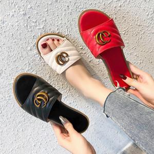 Joker ocio frescos zapatillas femenina piso nuevo verano versión coreana con la letra hebilla de metal desgaste de la manera antideslizante versátiles zapatillas