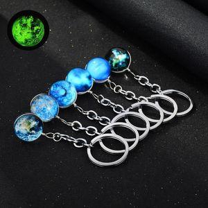 Nuovo Luminoso Glow in the Dark Portachiavi Galaxy Universe Glass Ball Cabochon Portachiavi Car Bag Portachiavi Creativo Portachiavi Regalo Gioielli