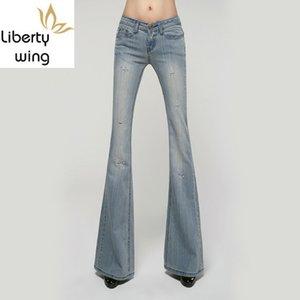 Verano Agujero rasgado dril de algodón delgado Pantalones acampanados Mujeres New Light Blue Jeans Vintage Casual Oficina Boot Cut largo pantalones femeninos